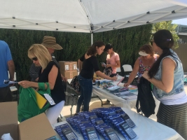 Attendees preparing the backpacks with items from list.